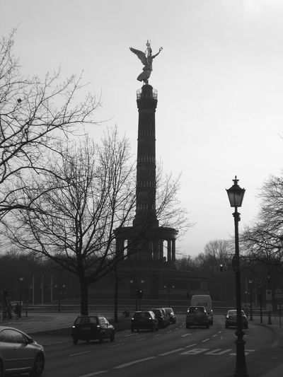 Victory column, Berlin Architecture Berlin Black And White Blackandwhite City Clock Day Holiday Holidays Melancholy No People Outdoors Sculpture Sightseeing Sky Statue Statue Traffic Travel Travel Travel Destinations Traveling Tree Victory Column Discover Berlin Black And White Friday