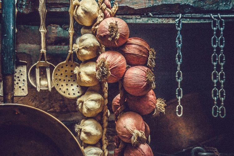 Onions and garlic hanging in kitchen