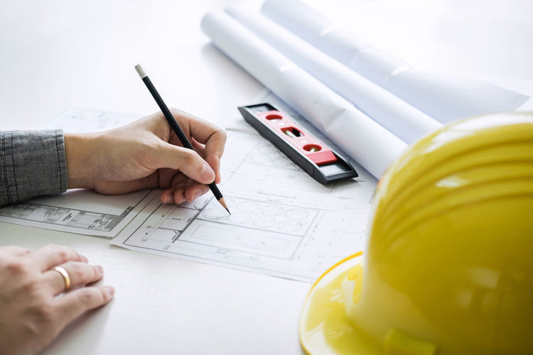 Human Hand Hand Human Body Part Pen People Planning High Angle View Writing Holding Business Adult Document Paper Communication Working Paperwork Blueprint Engineering Engineer Drawing Structure Construction Industry Helmet Building