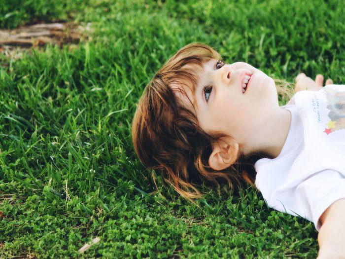 Boy lying on field