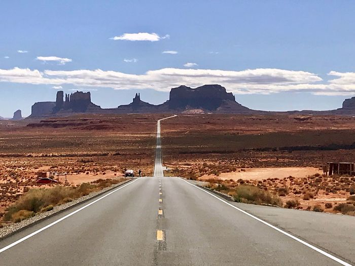 Run forrest run!! Roadtrip Monument Valley Road Direction Transportation Sky The Way Forward Cloud - Sky Road Marking Landscape Scenics - Nature Diminishing Perspective Nature Symbol Land Environment No People vanishing point Marking Empty Road Day Sign