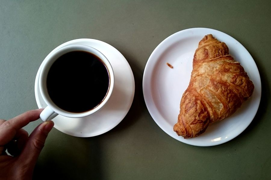 Croissant Breakfast Cafe Coffee - Drink Coffee Cup Food And Drink Human Hand Human Body Part Directly Above Drink Freshness Refreshment Bread Food High Angle View Plate Table Close-up People One Person Indoors  Adult
