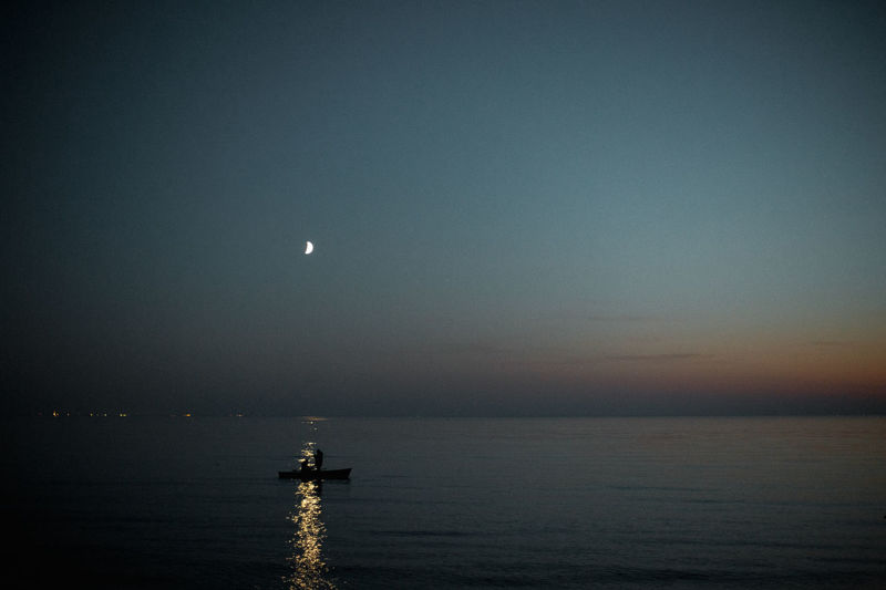 Sky Moon Water Scenics - Nature Beauty In Nature Tranquil Scene Sea Tranquility Night Waterfront No People Nature Space Idyllic Horizon Over Water Horizon Astronomy Full Moon Outdoors Moonlight Planetary Moon