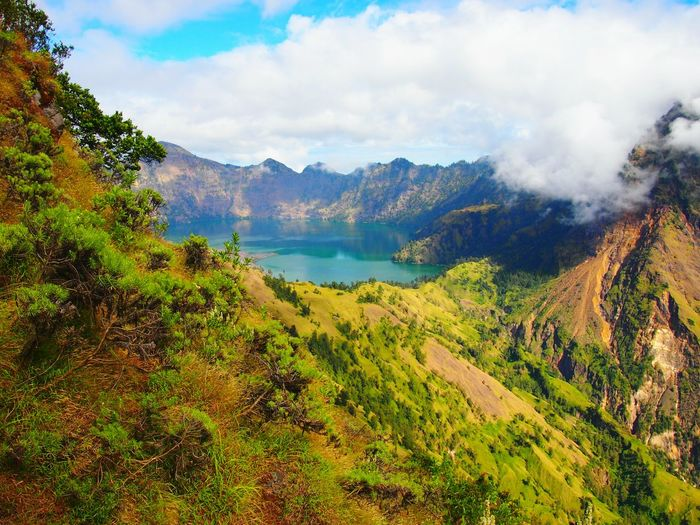Scenic View Of Segara Anak Lake And Active Volcano