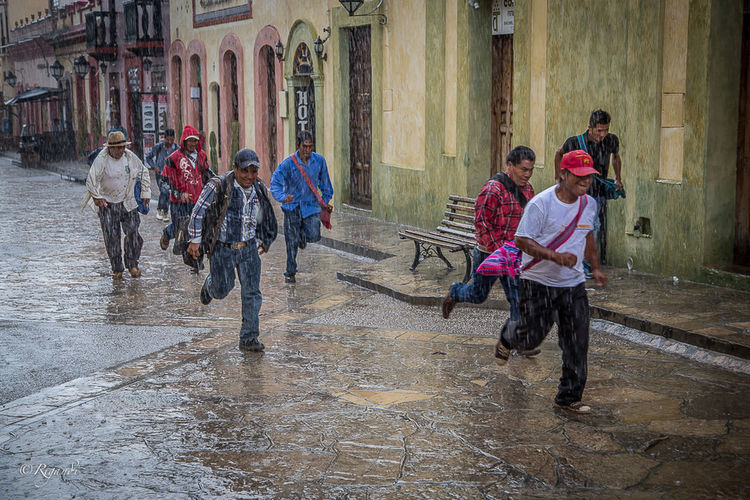 suddden showers followed up by sunshine Adult Architecture Boys Building Exterior Built Structure Child City Day Full Length Large Group Of People Leisure Activity Lifestyles Men Outdoors People Real People Togetherness Water Wet Women The Street Photographer - 2017 EyeEm Awards