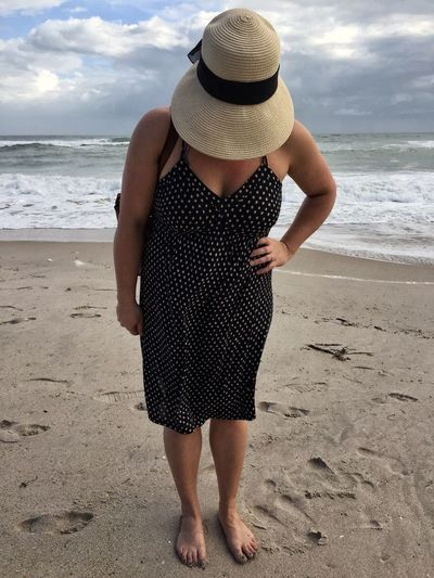 Sandy toes Hat Beach Sun Hat Sea Straw Hat Looking Down Vacations One Person Leisure Activity Beach Holiday One Woman Only Melbourne Beach, FL Young Adult Sandy Toes Vacations Young Woman
