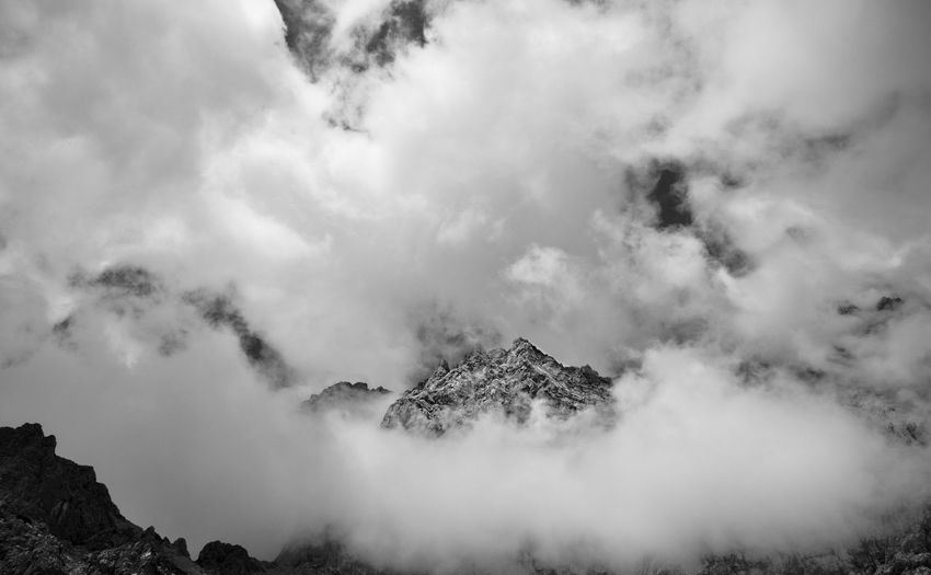 Clouds and fog cover the mountain peaks.