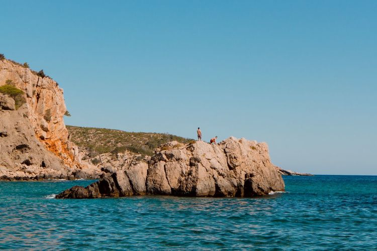 EyeEm Selects Sea Rock - Object Clear Sky Blue Rock Formation Water Nature Scenics Day Beauty In Nature Outdoors Waterfront Real People Horizon Over Water One Person Men Beach Full Length Sky People Ibiza Ibiza Beach Cala Xarraca