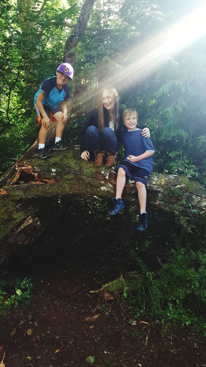 forest, real people, togetherness, tree, full length, leisure activity, casual clothing, day, boys, outdoors, lifestyles, nature, childhood, girls, happiness, young women, growth, friendship, adventure, smiling, young adult, men, people