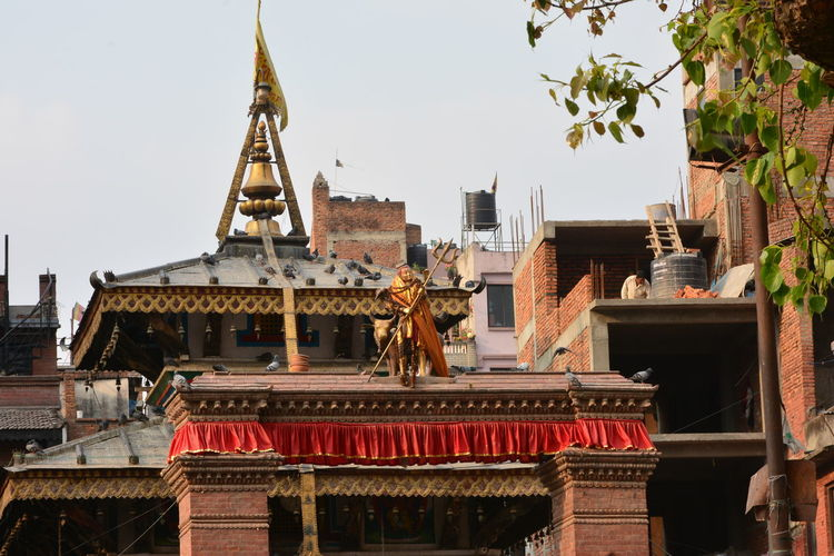 Kathmandu Nepal Architecture Art And Craft Basantapur Belief Building Building Exterior Built Structure City Clear Sky Day Low Angle View Nature No People Outdoors Place Of Worship Religion Roof Sculpture Sky Spirituality