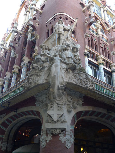 Architecture Building Exterior Built Structure City Day Low Angle View Music Hall No People Outdoors Palau De La Musica Catalana Sculpture Sky Statue