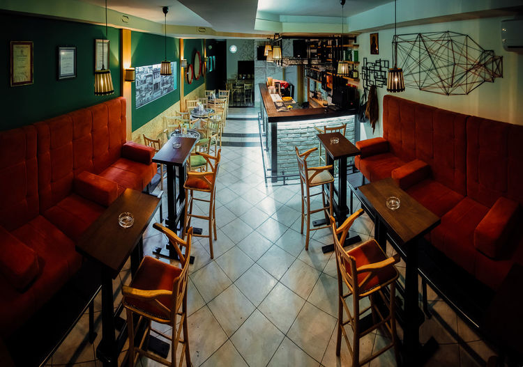 High angle view of chairs in restaurant