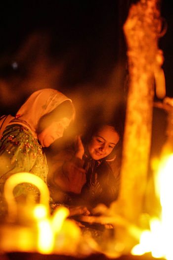 Iran Travel Destinations Travel Photography Nomadic Shia Community Travel Nomadic Life One Person Lifestyles Real People Flame Burning Fire Leisure Activity Indoors  Fire - Natural Phenomenon Women Glowing Front View Casual Clothing Child Portrait Selective Focus Young Adult Innocence
