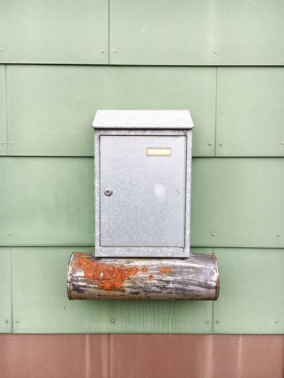 Mailbox on house wall