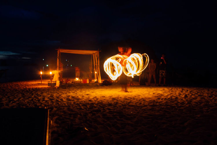 Arts Culture And Entertainment Illuminated Men Night One Person Only Men Outdoors People Performing Arts Event Wire Wool