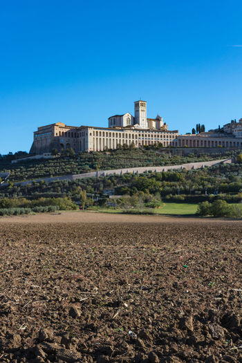 Abbey Autumn Basilica Church Country Field Saint Francis Of Assisi Architecture Blue Building Exterior Built Structure Clear Sky Countryside Day Europe Fall History Italy Nature No People Outdoors Religion Sky Umbria