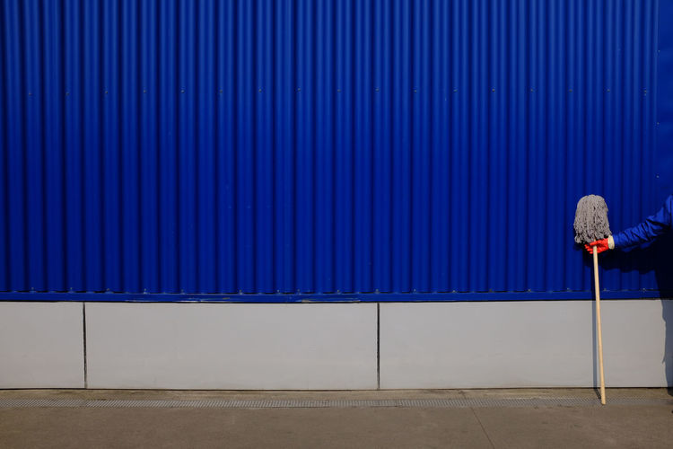 Architecture Blue Contrast Human Body Part Minimalism One Person Orange Color Pattern Street Photography Wall - Building Feature