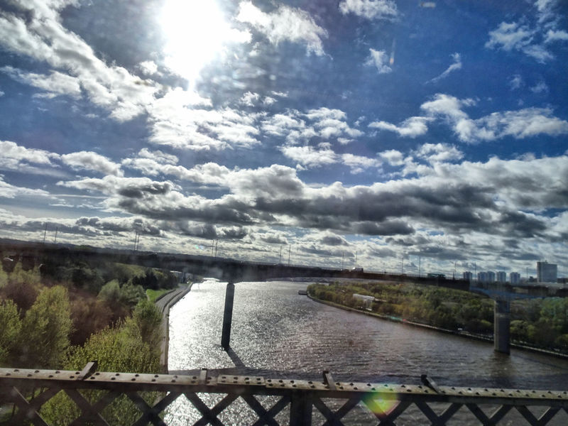 Architecture Beauty In Nature Built Structure Cloud - Sky Clouds And Sky Day From A Train Window Nature Newcastle Upon Tyne No People Outdoors River Tyne, Sky Sony Xperia Photography. Sunlight Tree