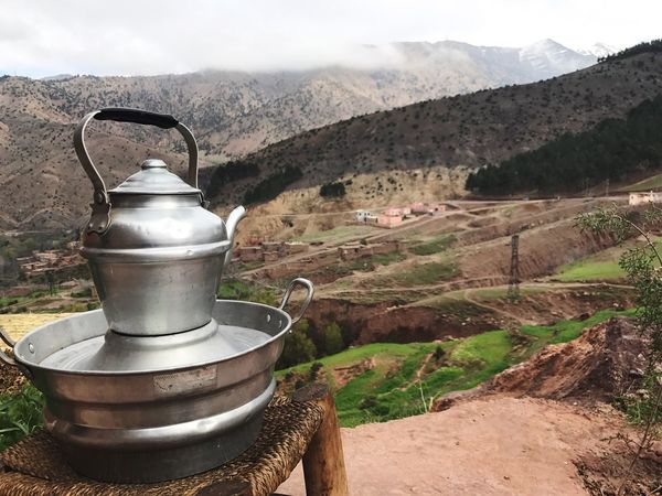 Mint tea with a Berber family in the Atlas Mountains of Morocco Mountain Range Mountain Tea Time Tea Landscape Berbervillage Atlas Mountain Atlasmountains Morocco Morrocobeauty Morroco Mountain Ranges Tranquility Tranquil Scene