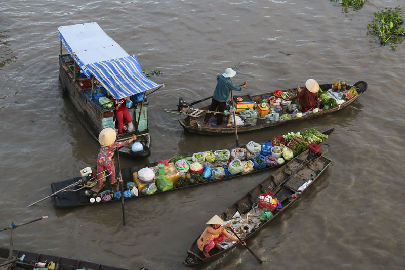 High angle view of people selling food in boat
