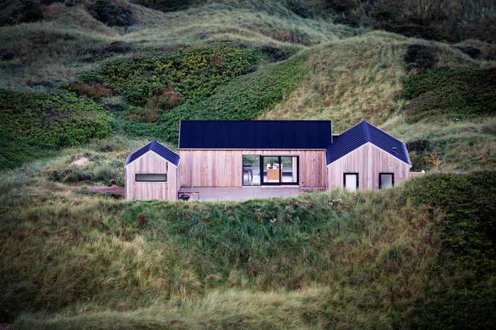 cabin in dunes Architecture Building Exterior Built Structure Cabin Cabin In The Woods Country House Day Farmhouse Field Grass House Landscape Mountain Nature No People Outdoors Scenics Sky Tree