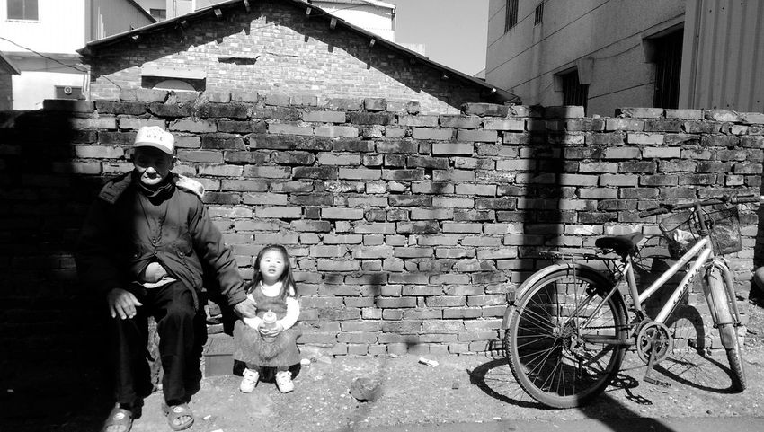 Granfather Taking Photos Black And White