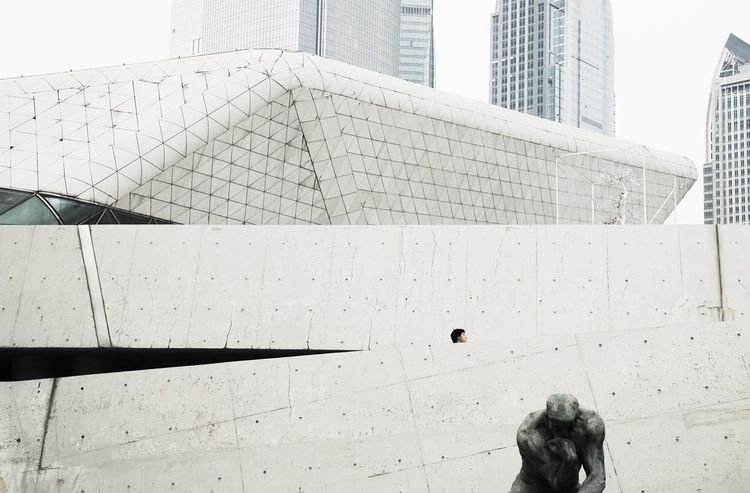 Clearing Minds, The Thinker. Check This Out Taking Photos Relaxing Enjoying Life Hello World EyeEm Best Shots EyeEm Minimalism Urbanism Urban Streetphotography Guangzhou China Architecture Great Thinkers Wall Guangzhou Opera House Urban Geometry Fine Art People Architecture Framing