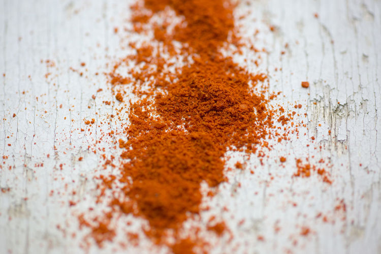 Close-Up Of Paprika On Wooden Table
