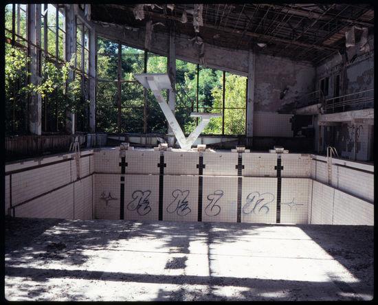 The abandonded public pool of Pripyat Abandonded Abandonded Building Abandonded Pool Adventure Analogue Photography Bassein Chernobyl Chernobyl 1986 Chernobyl Exclusion Zone Chernobyl Zone Clock Cyrillic Demolished Jumping Vault No People Pool Pool Clock Pool Lanes Pool Tiles Pripyat Soviet Pool Soviet Union Sportsal Travel Ukraine