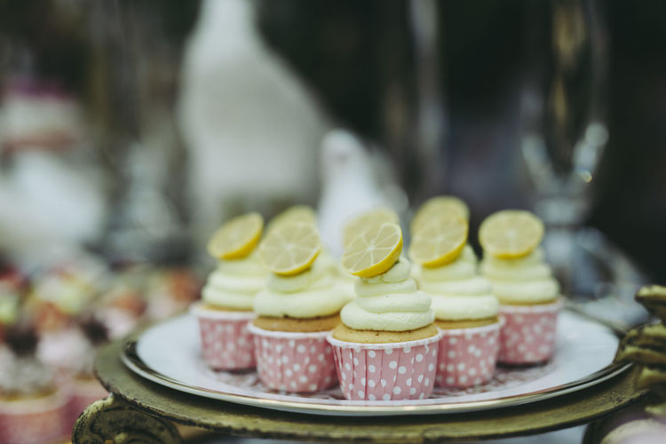 Close-up of cupcakes in plate at store for sale
