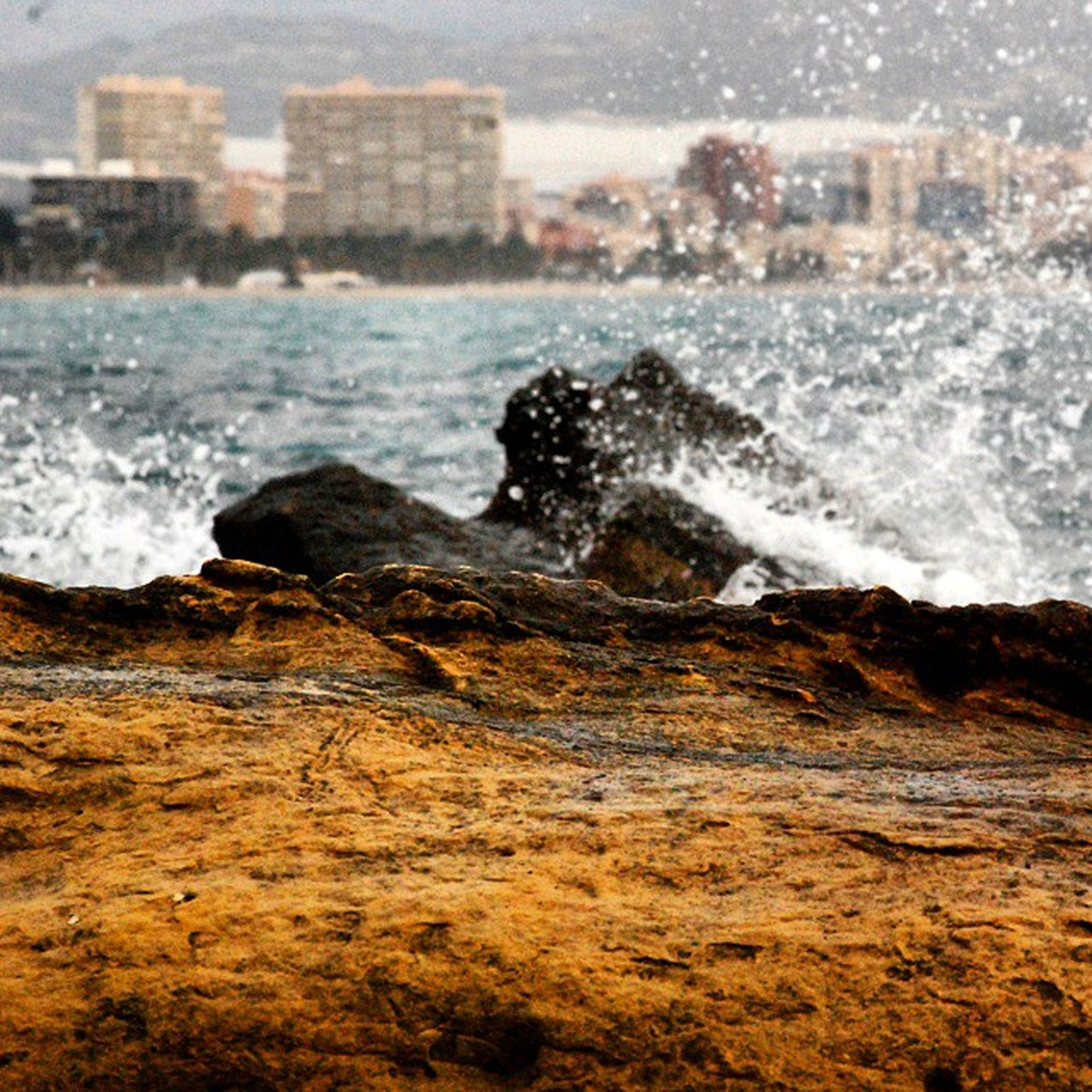 water, surf, wave, sea, splashing, motion, shore, rock - object, beach, power in nature, nature, beauty in nature, scenics, rock formation, rushing, outdoors, day, no people, coastline, rock