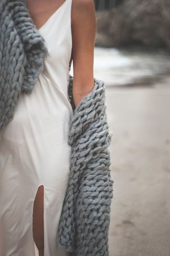 One Person Midsection Women Real People Lifestyles Clothing Adult Day Leisure Activity Focus On Foreground Warm Clothing Human Body Part Close-up Casual Clothing Hand Winter Beach Textile Scarf Standing