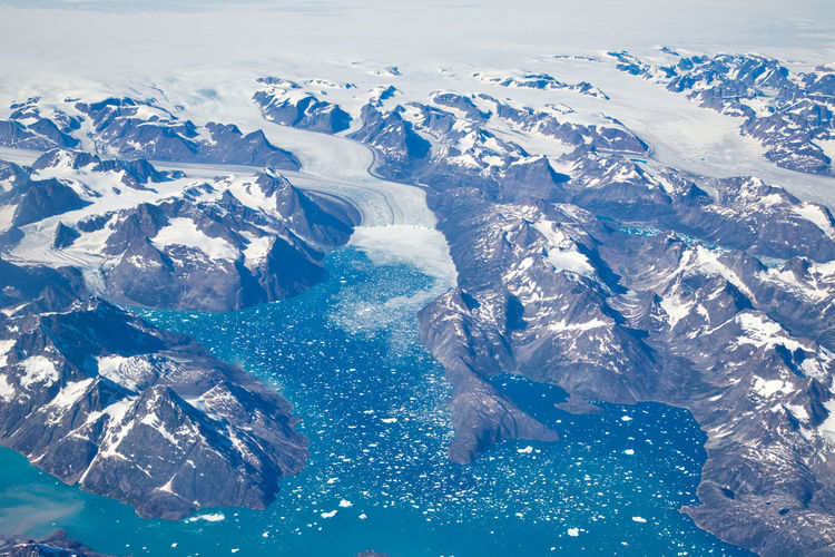 Aerial view of snowcapped mountains and sea