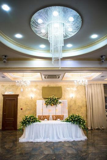 Illuminated chandelier in hotel