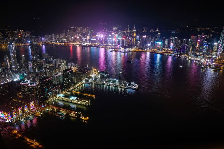 Victoria Harbour Nightshooters Nightphotography Discoverhongkong Night Illuminated Water City Architecture Building Exterior Built Structure Reflection No People Cityscape Sky Waterfront Outdoors Nightlife Glowing River Nature Multi Colored Building Light