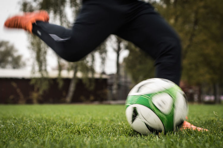 Adult Ball Capturing Motion Close-up Competition Competitive Sport Day Goal Grass Horizontal Human Body Part Kicking Limb Low Section One Person Outdoors People Person Soccer Soccer Ball Soccer Field Soccer Player Soccer Shoe Sport Sportsman