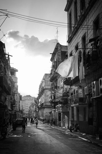Woman and sheets in Havana Architecture Building Building Exterior Built Structure Busy Cable Car City City Street Cloud - Sky Electricity  Incidental People Land Vehicle Mode Of Transportation Motor Vehicle Nature Outdoors Residential District Road Sky Street The Way Forward Transportation #FREIHEITBERLIN