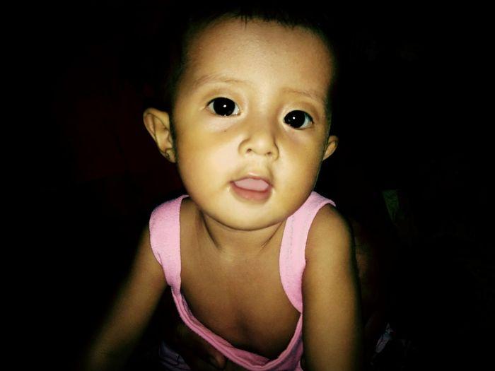 Portrait Of Cute Baby Girl In Darkroom