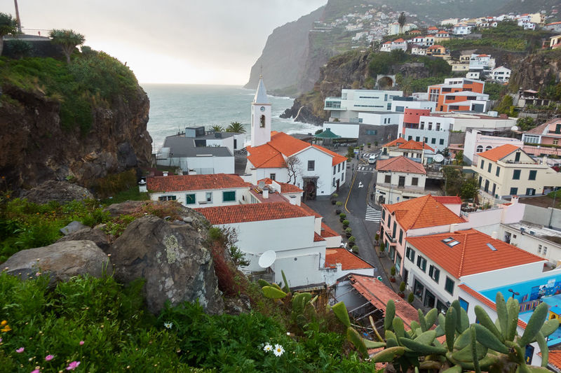View of São Sebastião church with Cape Girão, in Câmara de Lobos, Madeira Church City Cityscape Madeira Panorama Panoramic Portugal Portuguese Travel View Aerial Aerial View Architecture Building Cabo Girão Cape  Girao Ilha Island Landscape Mountain Outdoors Religion Religious  Seascape
