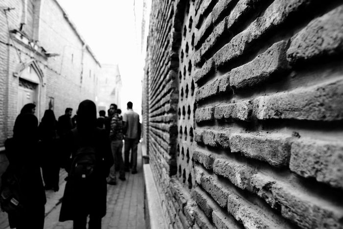 Alleyway Brick Wall Black & White The Photojournalist - 2015 EyeEm Awards A Week On Eyeem Shades Of Grey Telling Stories Differently The Street Photographer - 2015 EyeEm Awards People Walking  Eye Em in Shiraz, Iran