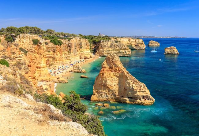 Praia da Marinha Praia Da Marinha Praia Rocky Coastline Rocks Summer Portugal Algarve Water Sea Scenics - Nature Land Blue Rock Beauty In Nature Beach Rock Formation Nature Tranquil Scene Tranquility Sunlight Clear Sky Horizon Over Water Rock - Object Day Sky