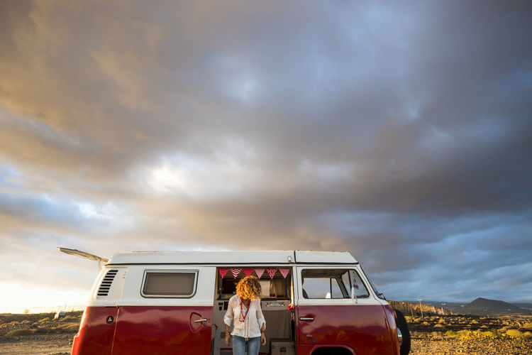 outdoor in nature young woman in relaxing trip with old vintage car Nature Old Vintage Cars Adventure Clouds Curly Hair Day Friendship Land Vehicle Landscape Lifestyles Mode Of Transport Motor Home Nature One Person Outdoor Relaxing Moments Sky Suggestive Technology Togetherness Vintage Dress Young Woman
