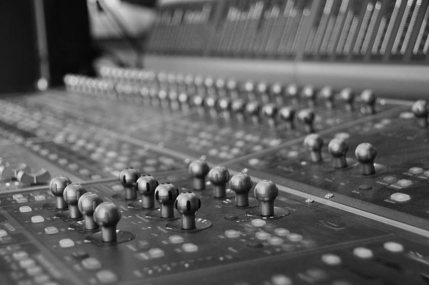 Mixing Desk in a Recording Studio Recording Session Sound Sound Desk Arts Culture And Entertainment Audio Equipment Close-up Control Control Panel Creativity Equipment In A Row Indoors  Knob Mixer Desk Mixing Music Record Recording Studio Selective Focus Sound Design Sound Mixer Sound Recording Equipment Studio Technology