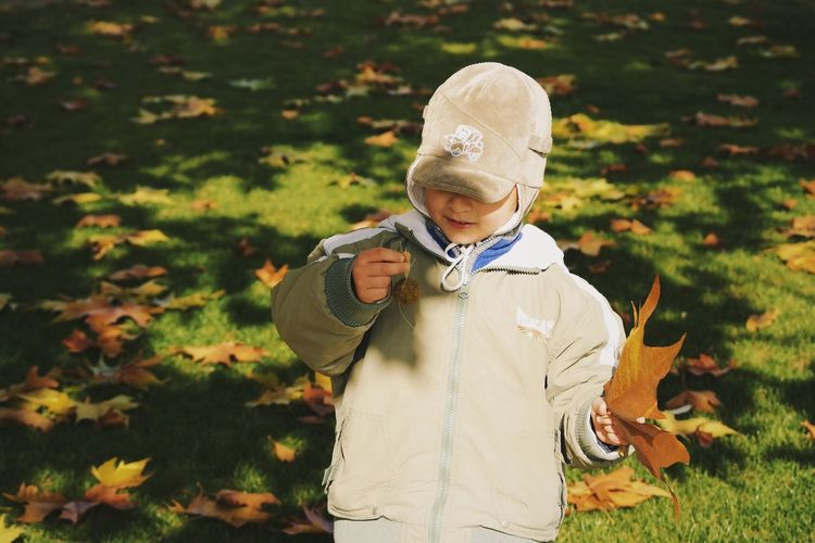 Autumn is magical...especially when you're a kid... Details Of My Life Fall Colors Autumn Colors City Life Autumn Leaves Kids Being Kids Children Leaf Nature Close-up Childhood Memories Human Body Part My Favorite Photo Found On The Roll Made In Romania Leisure Activity Park Casual Clothing Autumn Having Fun Child Vscocam Fun Childhood Children Only