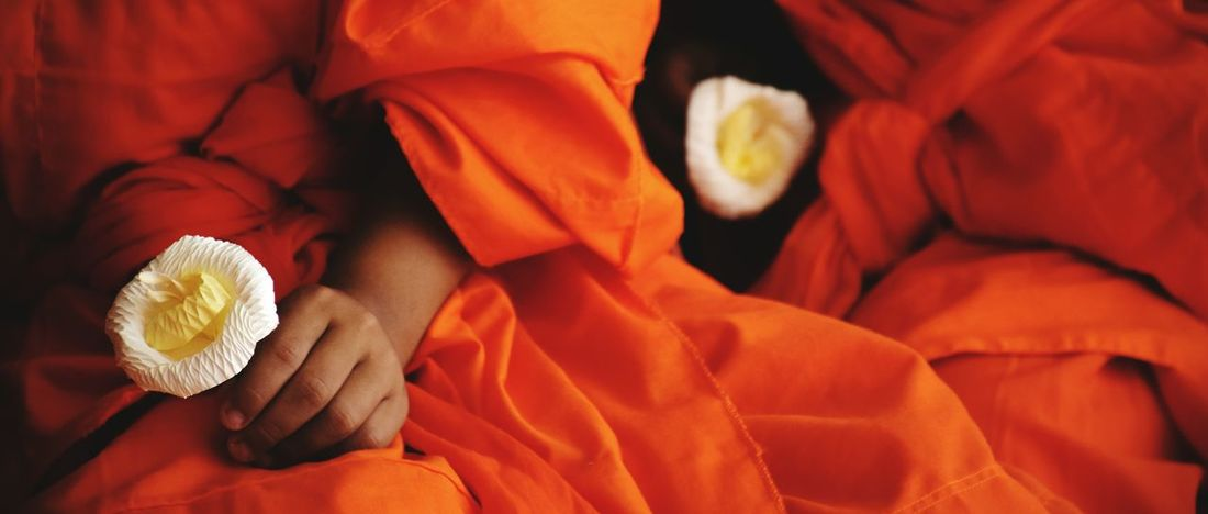 Priest Flowers EyeEm Selects Flower Buddhism Ceremonial Ceremony Monk  Orange Color Real People Human Hand Close-up People Day