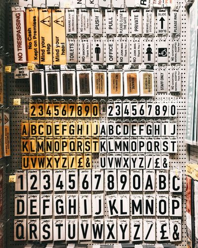 letter and number signs in a DIY shop Signs Signage DIY At Home Alphabet Numbers Number Letters Letter Hardware Store Hardware DIY Homebase Communication Text Full Frame No People Information Western Script Backgrounds Sign Still Life Typescript Large Group Of Objects