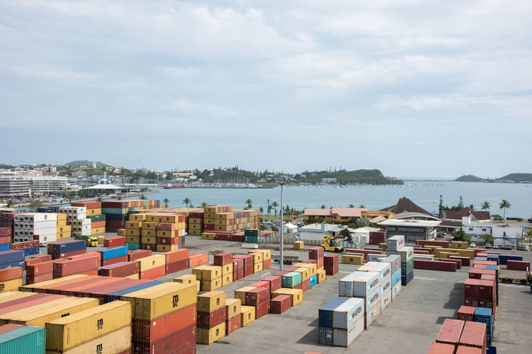NOUMEA, NEW CALEDONIA-NOVEMBER 25,2016: Shipyard with shipping containers and Pacific Ocean waters in Noumea, New Caledonia. Noumea Shipping Containers Transportation Abundance Architecture Cloud - Sky Collection Commercial Dock Day Dockside Freight Transportation Landscape Large Group Of Objects Nature New Caledonia Outdoors Pacific Ocean Port Sea Sea Container Shipping  Shipyard Vibrant Water Waterfront