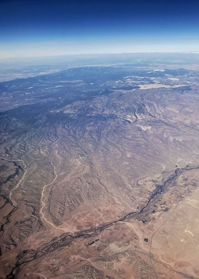A river runs through it. Vertical Arid Landscape Rugged Landscape Western USA Drainage Channel Drainage River System Desert Curvature Of The Earth Aerial View Landscape Scenics Nature Beauty In Nature Tranquil Scene Outdoors View Into Land Arid Climate Remote