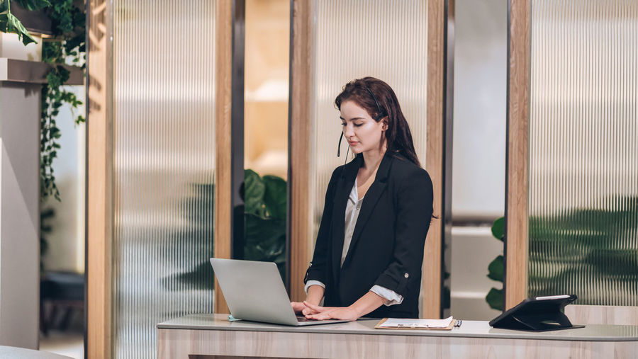 Receptionist and businessman at hotel front desk