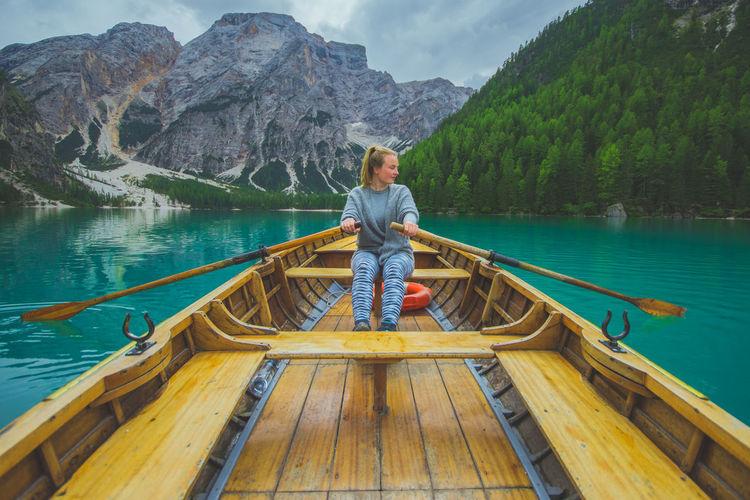 Woman rowing boat in lake